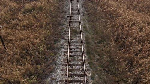 Above old railway track in prairie 4K aerial footage