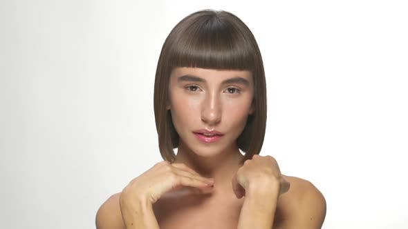 Beautiful Woman with Straight Short Hairstyle and Naked Shoulders Posing