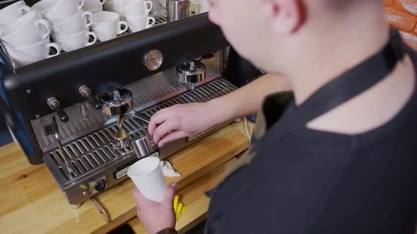 Cover Image for Process of Making Espresso in a Coffee Machine. Barista Making Latte in Specialty Coffee Shop.