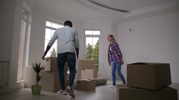 Cover Image for Happy Couple Carrying Boxes Into New House