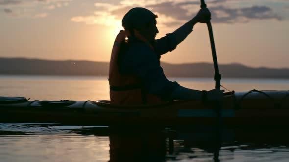 Thumbnail for Kayaking in Light of Setting Sun
