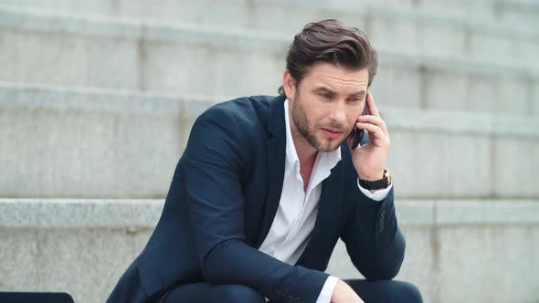 Thumbnail for Business Man Talking on Cellphone at Street. Worried Businessman Using Phone