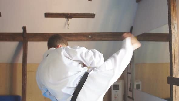 Thumbnail for Man Training Karate in Gym