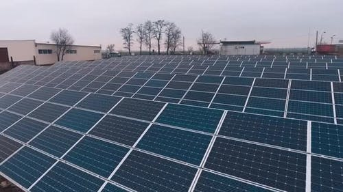 Solar panels in rural area. Solar energy panels in countryside from above
