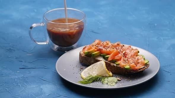 Thumbnail for Lachs-Sandwich und Kaffee. Gesundes Frühstück oder Snack