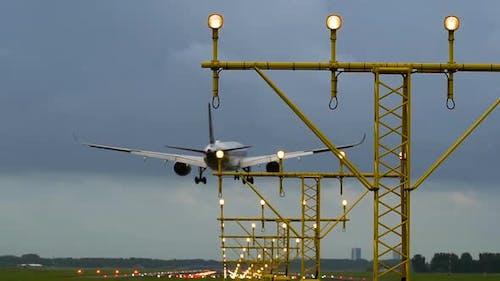 Aircraft landing on illuminated runway