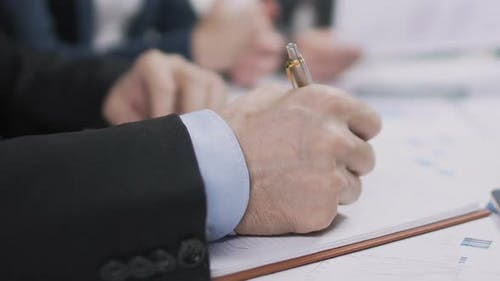 Male Lawyer Writing List of Priorities in Notebook, Runup of Election Campaign