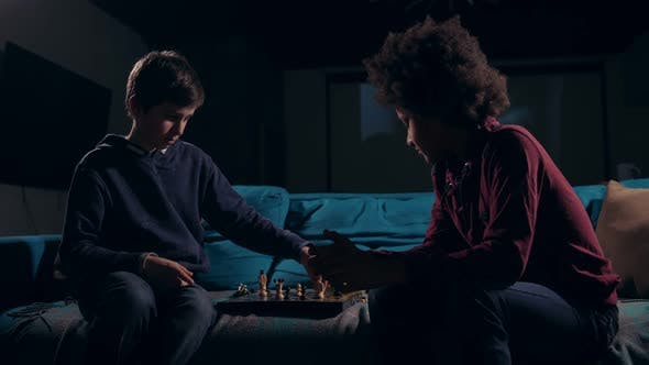 Thumbnail for Diverse Teen Chess Players Ending Game at Night
