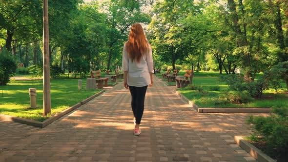 Thumbnail for Back View Ginger Girl Walks on the Street