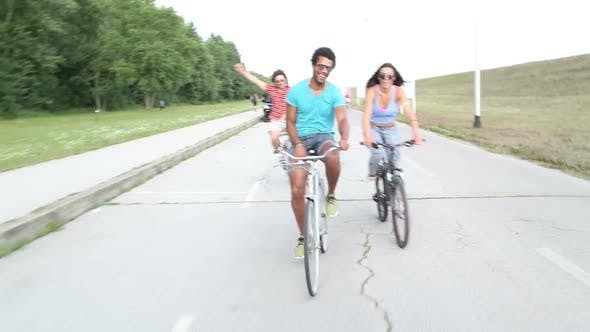 Thumbnail for Three young adults having fun cycling