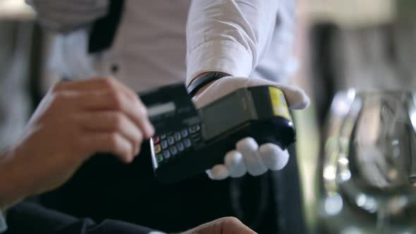 Thumbnail for Male Hands Paying By Credit Card at Terminal at Restaurant. Credit Card Payment