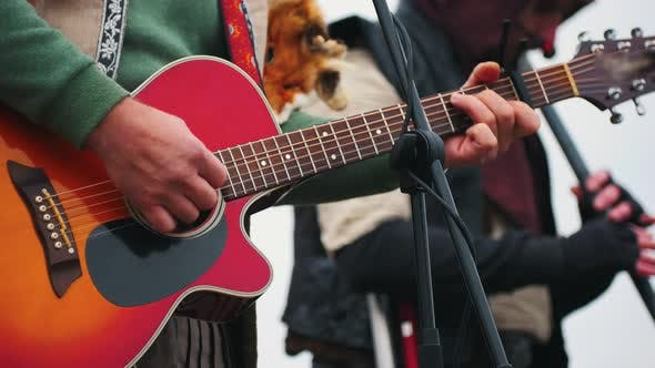 Thumbnail for A Music Band Playing Instruments on Stage on the Festival - a Man Wearing Fox Skin