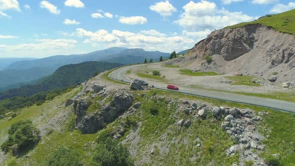 Thumbnail for Drone Footage of Car Passing Another Car on Mountain Road in Bulgaria