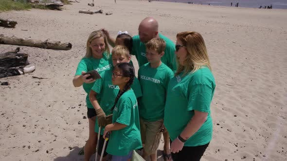 Thumbnail for Volunteers taking photo together at beach cleanup