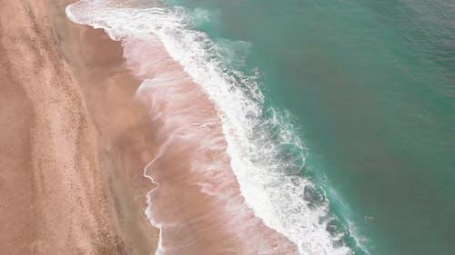 Empty sea coastline with blue sea waves during epidemic of coronavirus Covid-19 pandemic.