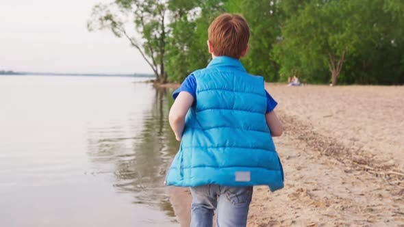 Thumbnail for Boy Run on Sandy Beach Along Coastline at Summer Day