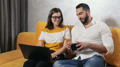 Young Couple Does Online Shopping