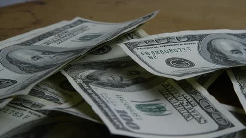 Rotating stock footage shot of $100 bills - MONEY 0158