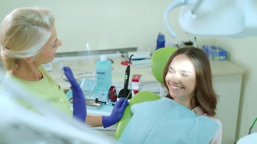 Female Patient on Regular Review of Dentist in Clinic. Patient with Doctor