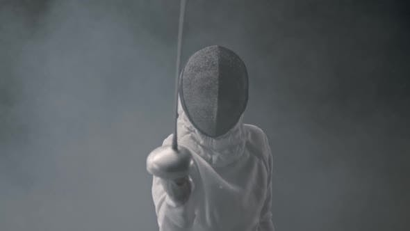 Thumbnail for Fencing Training in the Dark Studio - Young Woman Fencing in the Smoke