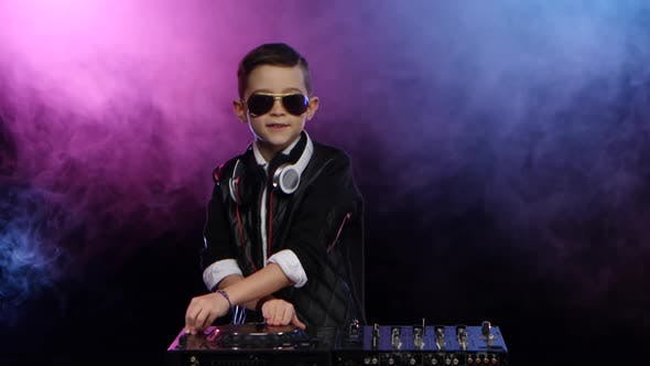 Thumbnail for Stylish Boy Dj with Glasses Playing on Vinyl. Smoky Background