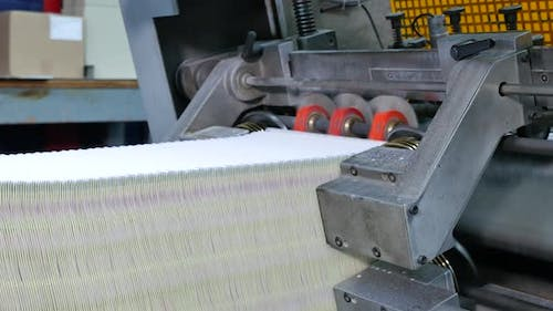 Industrial process of making envelopes in a factory