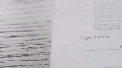 Signature on Contract By Pen in Hand