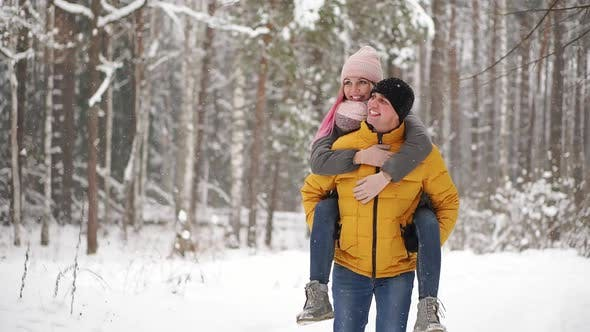 Cover Image for Happy Loving Couple Walking in Snowy Winter Forest, Spending Christmas Vacation Together. Outdoor