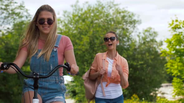 Cover Image for Teenage Girls or Friends with Bicycle in Summer