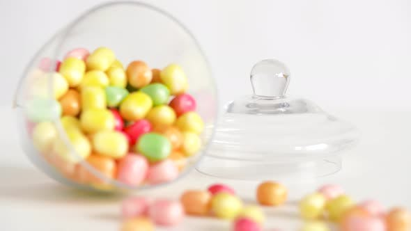 Thumbnail for Close Up of Scattered Candy Drops and Jar on Table