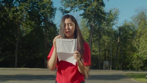 Thumbnail for Crying Student Reading University Dismissal Letter