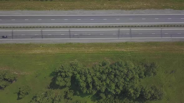 Thumbnail for Aerial Shot of Tourist Bus Driving on Highway