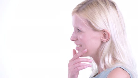 Thumbnail for Closeup Profile View of Happy Young Beautiful Blonde Woman Talking