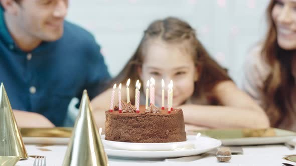 Thumbnail for Closeup Smiling Birthday Girl Blowing 12 Birthday Candles in Luxury House.