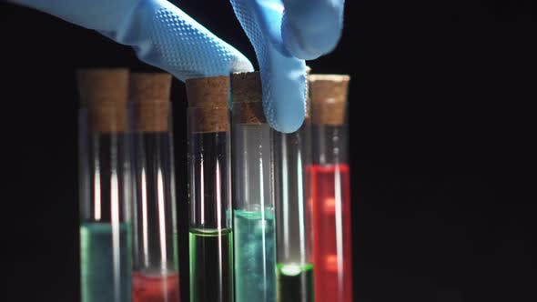 Lab Technician Opens a Test Tube with Boiling Liquid, Close-up of a Hand