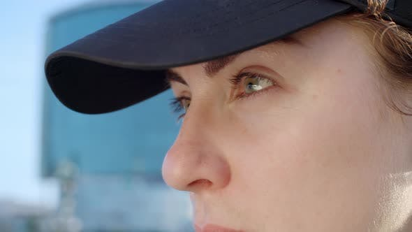 Thumbnail for Determined Sportswoman Gazing into Distance