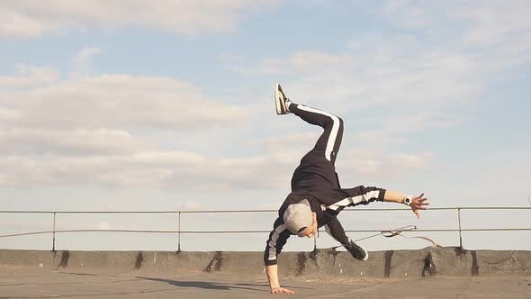 Thumbnail for Man Freestyle Hip Hop Dancing on the Roof