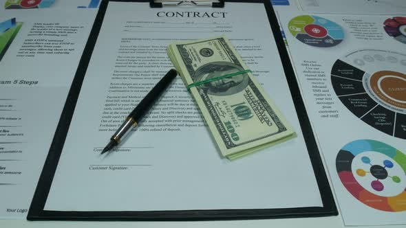 Thumbnail for Business Contract And Dollars On The Desk In The Office Of A Modern Company