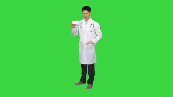 Thumbnail for Medical Doctor Holding a Box of Pills Promoting Them and Dancing on a Green Screen, Chroma Key