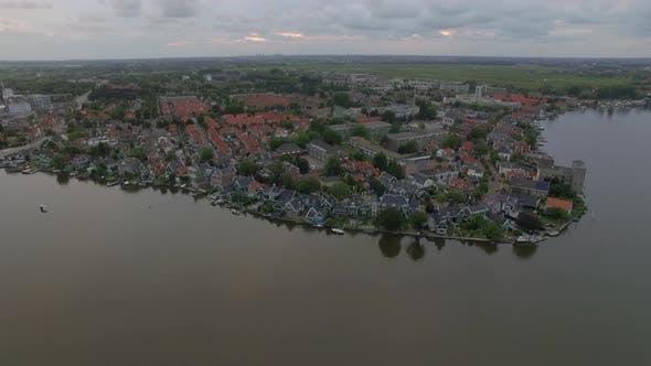 Thumbnail for Flying over riverside township in Netherlands