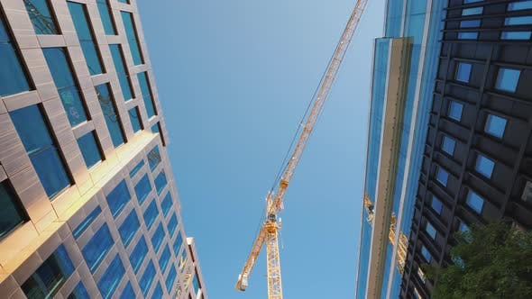 Thumbnail for Large Construction Crane in the City Center Near Glass Office Buildings