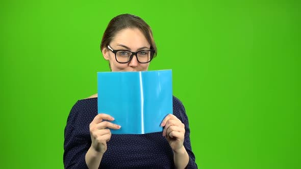 Thumbnail for Smart Girl Is Reading a Book. Green Screen