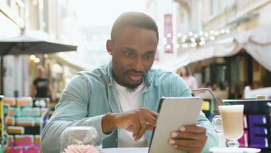 Thumbnail for African American with Stylish Beard and in Round Earrings Browsing Internet
