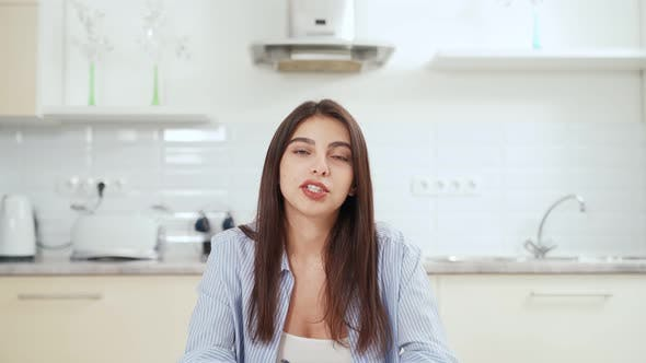 Cute Woman Telling Something Online on Laptop at Home