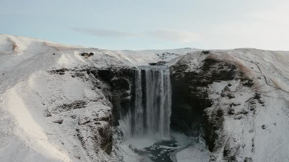 Aerial View of Skogafoss Waterfall During Sunrise, Iceland in Early Spring