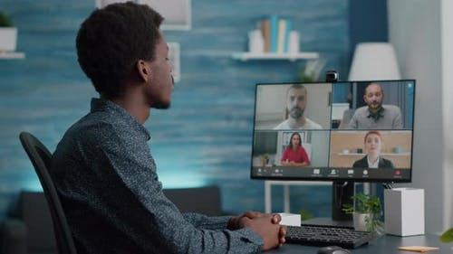 Selective Focus on African American Man on Online Conference Video Call
