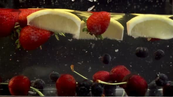 Thumbnail for Lemons, cherries and berries soaked in transparent liquid