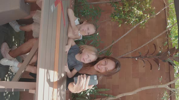 Mother Making Selfie with Her Children