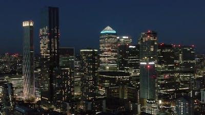 Downtown skyscrapers illuminated at night, London, UK