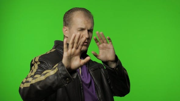 Thumbnail for Confused Rocker Man Covering Eyes with Hand and Showing Stop Gesture, Expressing Disgust To Seen